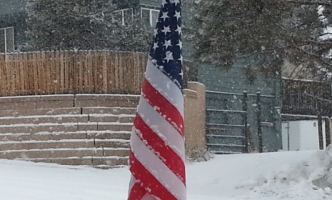 Snow accumulating on the flag.